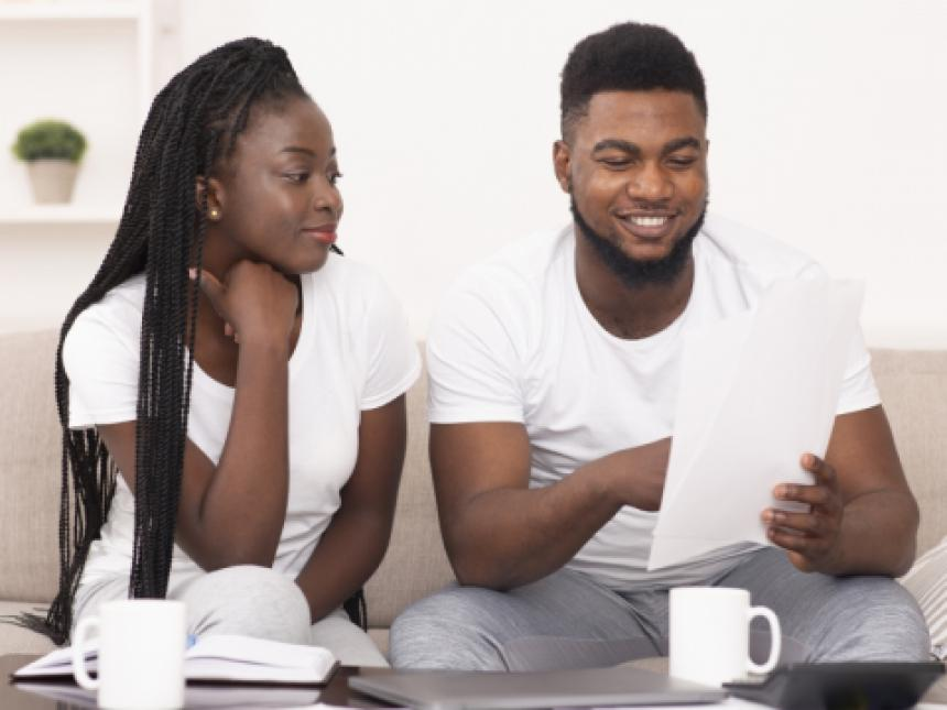 Young couple working on finances.