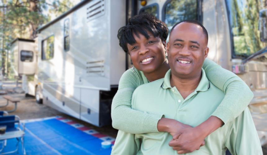 Happy couple with an RV.