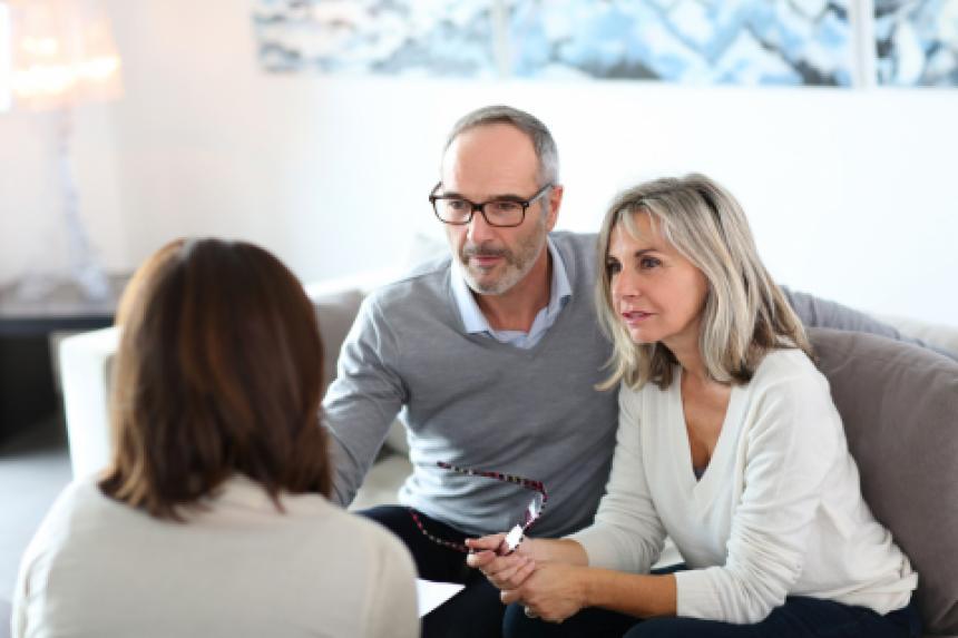Grey haired couple seeking advice