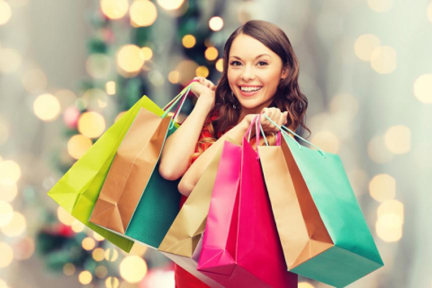 Lady holiday shopping. Holding multiple shopping bags