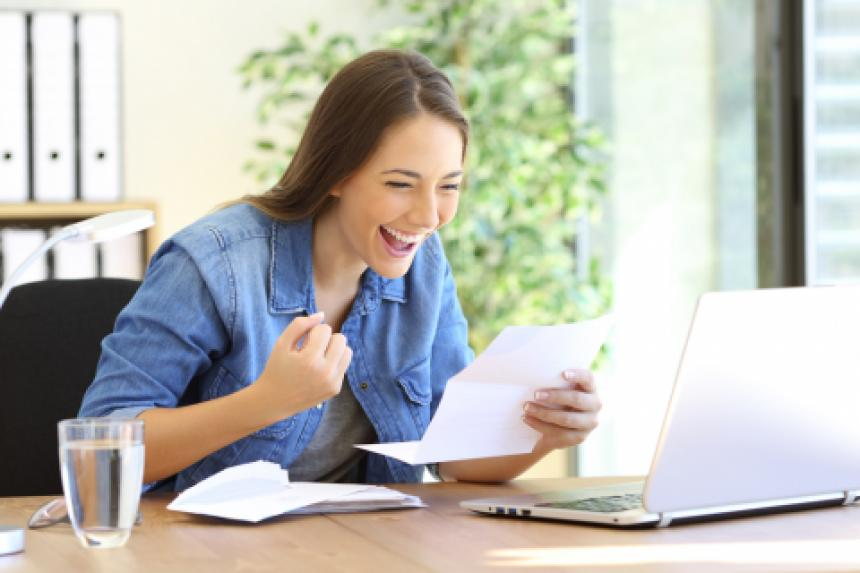 young woman excited about tax refund
