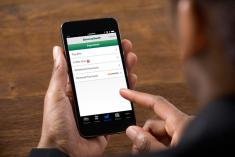 Person using mobile banking app