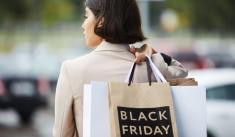 """Shopper holding a bag labeled """"Black Friday"""""""